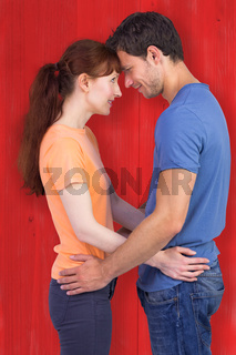 Composite image of couple looking at each other