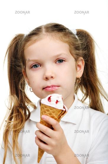 Joyful child girl eats ice- cream isolated