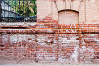 Ancient immured door in the red brick wall