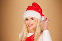 Merry young woman in a red Santa hat