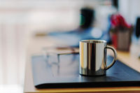 Office desk with coffee cup