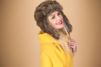 Pretty smiling blond woman in a winter hat