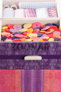 Buttons and textile fabrics in a beautifully designed sewing box
