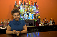 Young woman at the bar counter in her restaurant