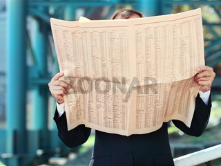 Close up of the hands of the businessman with a newspaper
