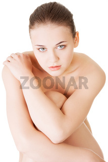 Attractive naked woman. Close up on face. Portrait.