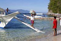 Unloading a typical Ferry Boat on the Big La Laguna Beach on Mindoro Island