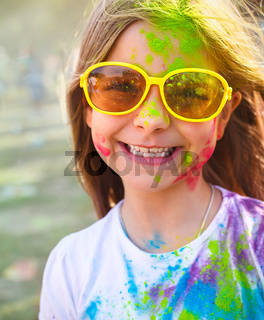 Happy cute litttle girl on holi color festival