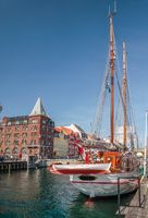 Old sailing ships and houses in Nyhavn in Copenhagen