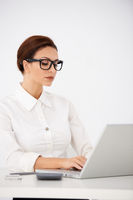 Serious Office Woman Typing on Laptop