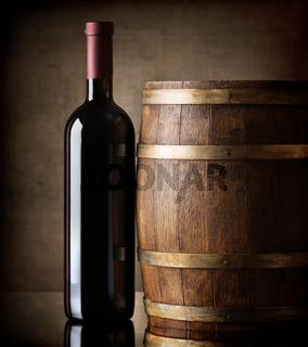 Bottle and wooden barrel
