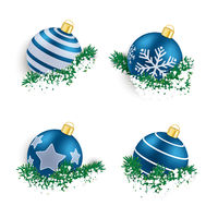 Blue Christmas Baubles in Twigs Snow