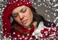 Sick Woman with Tissue and Snow Effect Surrounding