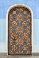 Old building door decorated with golden ornaments