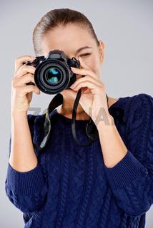 Female photographer taking a photo