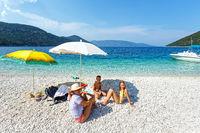 Family on Antisamos beach (Greece,  Kefalonia).