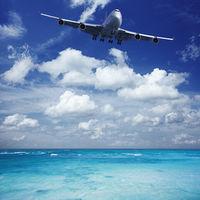 Jumbo jet is landing at seaside airport