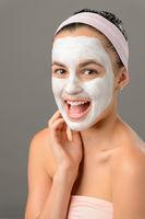 Teenage beauty smiling girl white facial mask