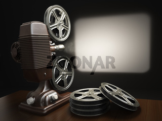 Cinema, movie or video concept. Vintage projector with projecting blank and reels of film.