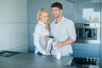 Attractive couple having morning coffee
