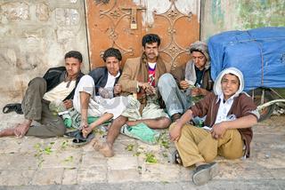 boys chewing khat qat leaves in street sanaa yemen