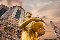 Big statue of Golden Buddha in Wat Arun or Temple of Dawn. Thai traditional Buddhist architecture in Bangkok, Thailand