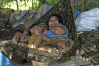 Mother with sleeping toddler in a hammock