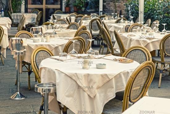 Empty restaurant tables in the Italian city of Venice