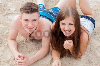 young happy couple in summer holiday vacation summertime