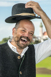 Laughing traditional bavarian man