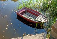 Small red Boat at the Lake