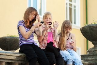 Group of school girls calling on the cell phones