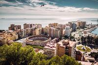Aerial view of Malaga bullring and harbor. Spain