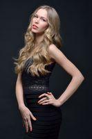 Beautiful woman in a black evening dress,