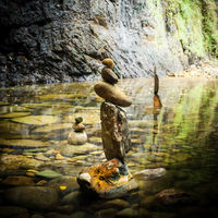 Amazing tropical rain forest landscape with lake and balancing rocks tower for zen meditation practice. Nature background