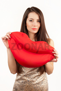 Young woman holds a big red lips