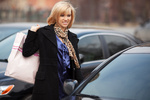 Young woman with shopping bags on the car parking
