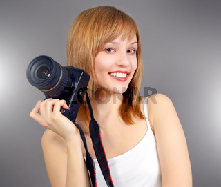 Teenage girl with digital camera