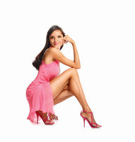 Portrait of beautiful brunette woman in pink dress. Fashion photo