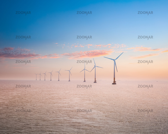 offshore wind power plants in sunset