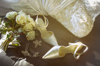 Wedding shoes with bouquet of white roses