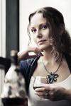 Sad beautiful woman drinking cognac at restaurant