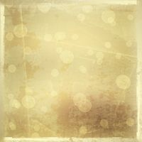 Gold backdrop for greetings or invitations with blur bokeh