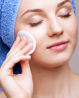 woman with makeup cotton pad