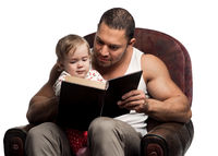 Father reading book to daughter, isolated on white background