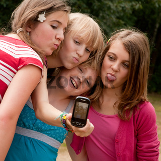 With four girls making a photo
