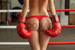 Image of female boxer's elastic ass in thong