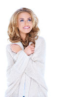Happy Blond Woman in Knit Cardigan Looking Up