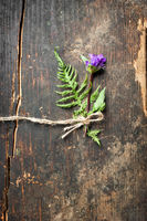 Beautiful summer meadow flower decoration on wooden background. Floral composition in rural vintage style