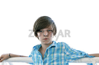 portrait of a cool male teenager  leaning on a reeling
